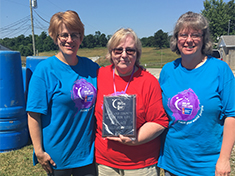 Michelle Meddock, Gayle Mackay, and Angie Moots holding the First Place for Small Business Plaque