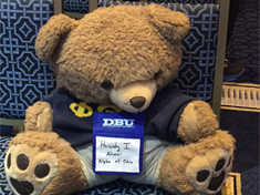 Phi Theta Kappa teddy bear participating in the Nerd Nation Conference